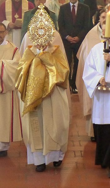 Priest with Monstrance